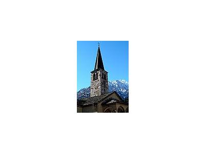 Photo Small Church Tower With Mountain In Background Building