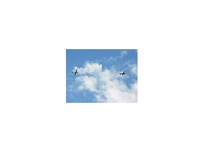 Photo Small Sailplane Towing 2 Vehicle